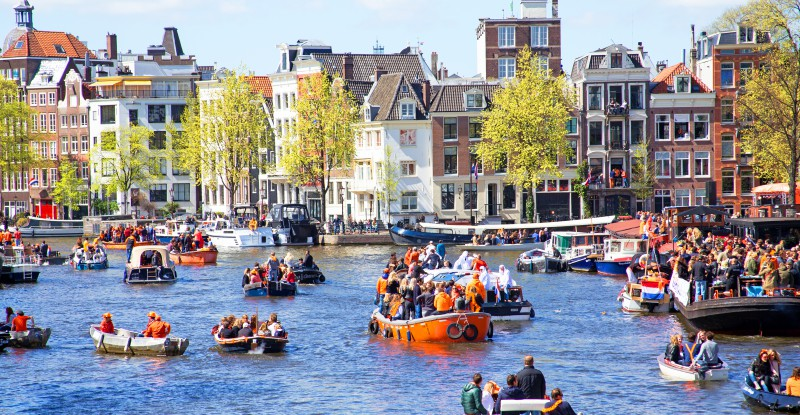 AMSTERDAM – APR 27: People celebrating Kings Day in Amsterdam on