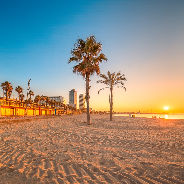 Barceloneta Beach in Barcelona with colorful sky at sunrise